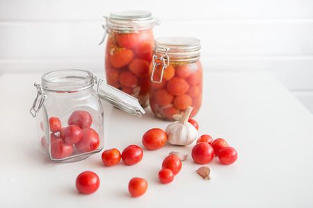 marinated: pots of marinated tomatoes and other ingredients