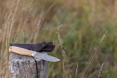 damascus: damascus steel knife for hunting on log Stock Photo