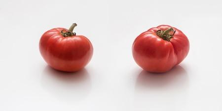 group of fresh tomatoes on white background Stock Photo