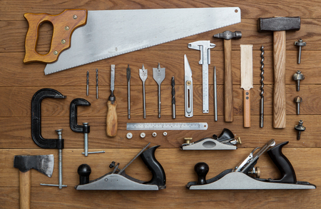 assorted tools for carpenter on wood background Stock Photo