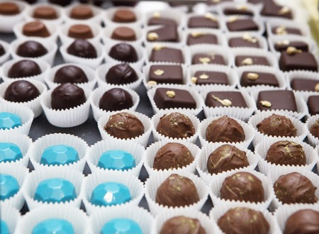 bonbons: showcase with assorted chocolate candies in daylight Stock Photo
