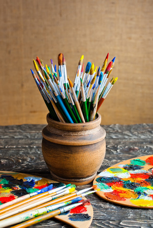illustrating: Paints and brushes