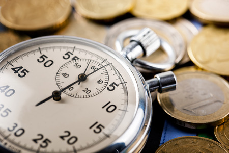 monedas antiguas: el tiempo es dinero  Foto de archivo