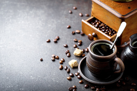 Coffee in a cup on old background