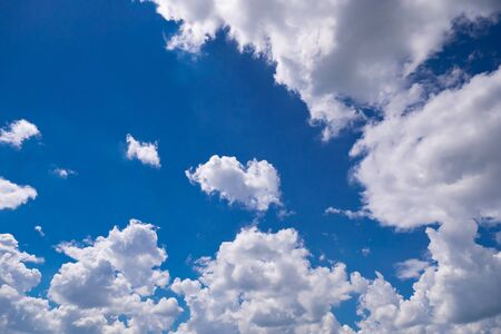 Blue sky with clouds in summer sunny day Stock Photo