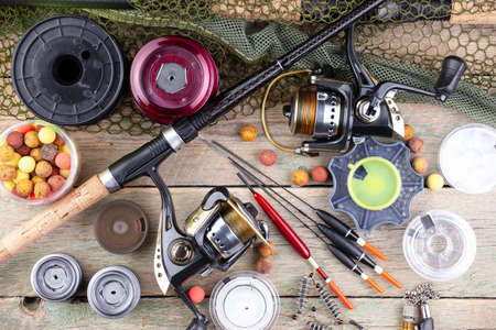 Spinning and fishing rods on an old background