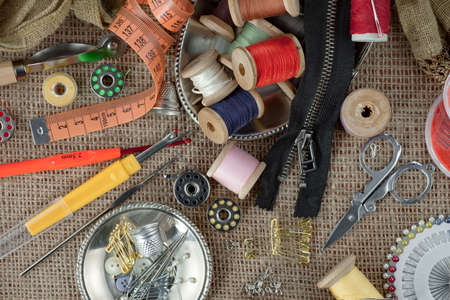 Threads, needles and sewing items.
