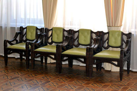 acts: Lonely chairs in an isolated room, acts as background and backdrop Stock Photo