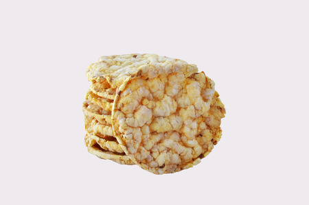 galettes: Round  corn cakes on wooden white table.