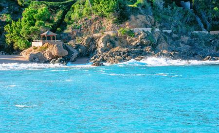 sa: Spain. Catalonia. Costa Brava. Beach Sa Riera. Beautiful views of the Mediterranean coast. Tourist places. The picturesque promenade along the sea. Stock Photo
