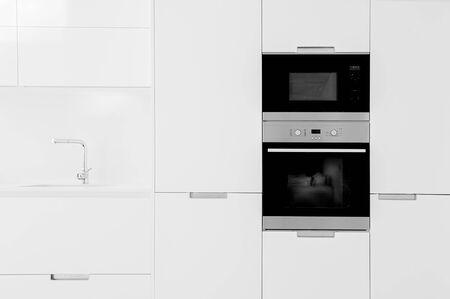 White empty classic kitchen in front view. Kitchen backgraund.