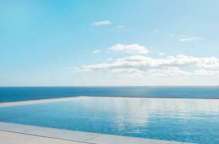 Luxury swimming pool in front of the sea. Swimming pool with beautiful sea and sky view. Фото со стока