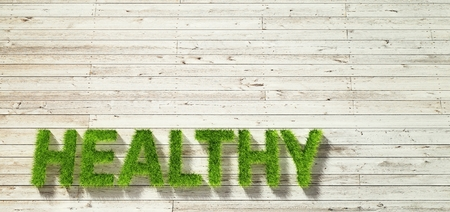 healty: healty made of grass on white wood background Stock Photo