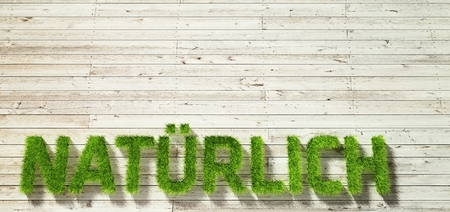 white wood: natuerlich made of grass on white wood background Stock Photo
