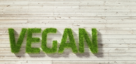 white wood: vegan made of grass on white wood background