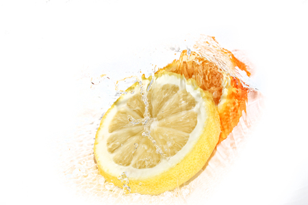 Water splash on lemon and orange slices