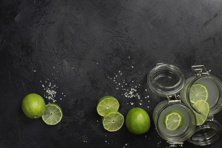 cocktail mixer: lime juice in glasses on dark stone