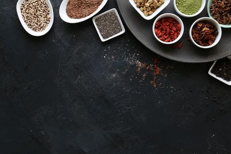 Super Food in bowls on dark ground