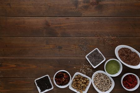 Super Food in bowls on dark wood