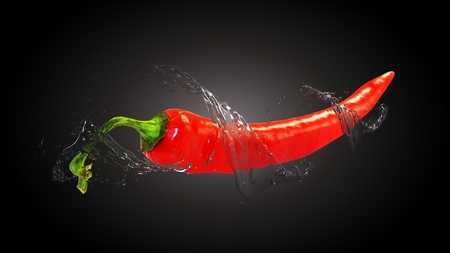 capsaicin: red chilly pepper on black background with water splash Stock Photo