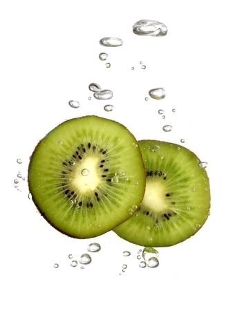 Bubbles forming in water after kiwi dropped into it.