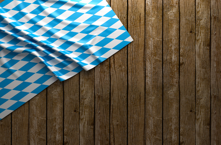 Rustic background for Oktoberfest with bavarian white and blue fabric on wooden - 3D rendering