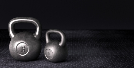 Fitness background with kettlebells on dark Background
