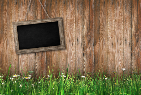 Blackboard on wood background with grass on the ground