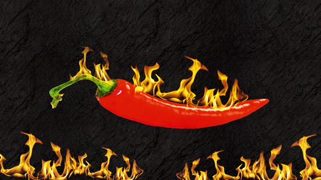 Red hot chili pepper on black background with flame Stock Photo