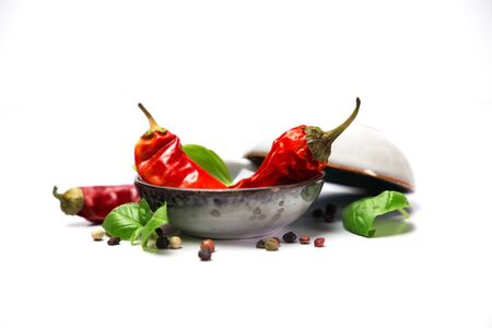chilli pepper and basil leaves still life isolated on white backgroun Stock fotó