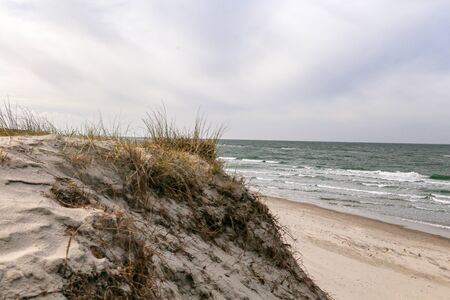 Dune at the Baltic Sea, Grass sand dune beach sea view Stock fotó