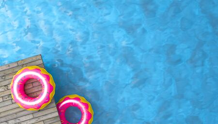 colorful inflatable ring donut toy in swimming pool water,3d rendering Standard-Bild