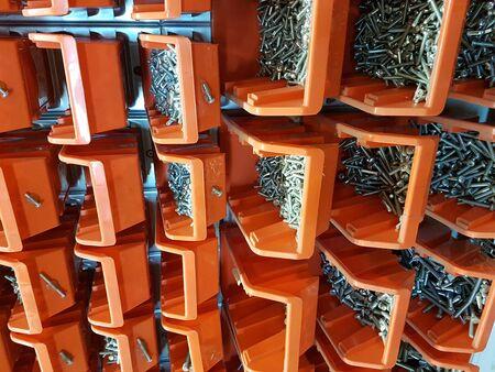 Screws in orange storage boxes in a workshop