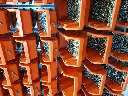 Screws in orange storage boxes in a workshop