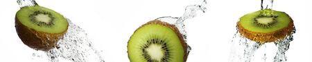 Fresh pieces of kiwi in water splash, isolated on white background Standard-Bild