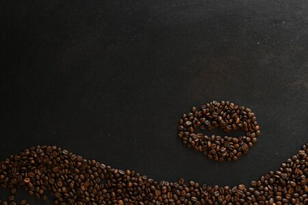 coffee beans in the shape of a bean on dark background 写真素材