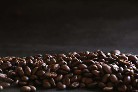 Coffee beans close up in dark ground
