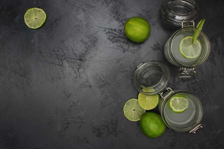 lime juice in glasses on dark stone