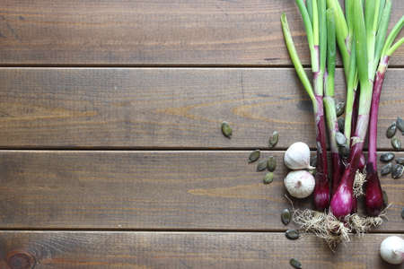 a group of spring onions on wooden background 写真素材