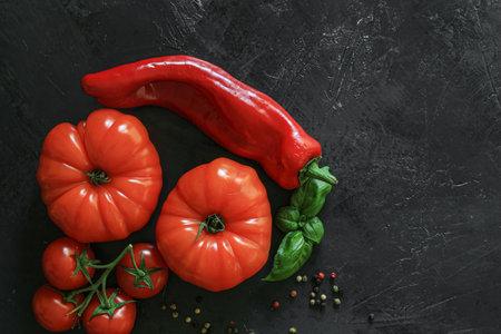 Fresh Coeur de boeuf tomato on a dark background