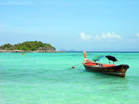 Longtail boat in Andaman sea, Lipe island, Thailand photo