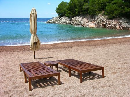 Two chairs on empty beach in Montenegro Stock Photo - 7319643