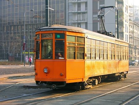 Old orange tram in Milan, Italy