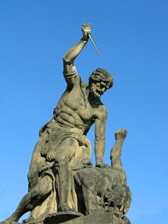 titan: Battling Titan at the Gate of Hradcany Castle in Prague, Czech Republic