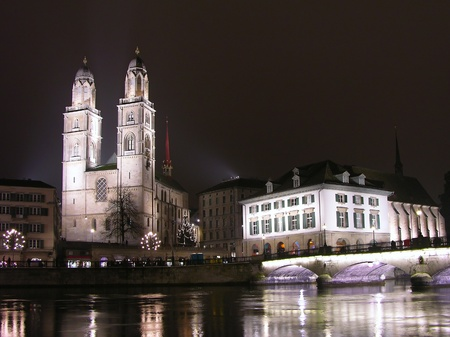 Grossmunster and Limmat river at night, Zurich downtown, Switzerland photo