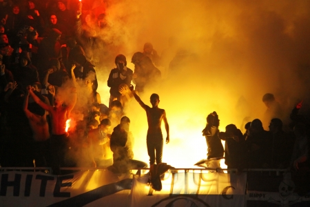 Kyiv, Ukraine - November 21, 2010 - FC Dynamo Kyiv supporters burn flares during the game against FC Metalist Kharkiv