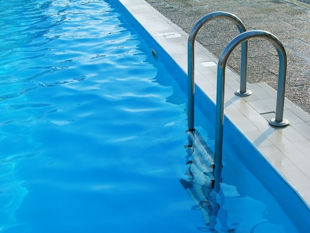 Swimming pool with stairs Stock Photo