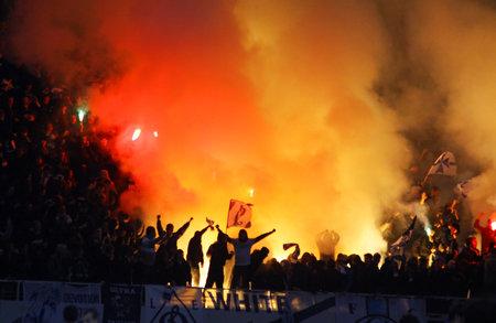 dynamo: Kyiv, Ukraine - November 21, 2010: FC Dynamo Kyiv supporters burn flares during the game against FC Metalist Kharkiv (Ukraine Championship)