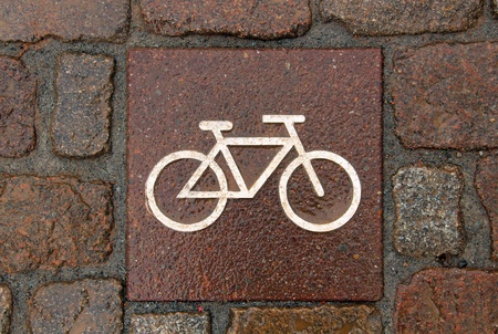 Bicycle sign on the road photo