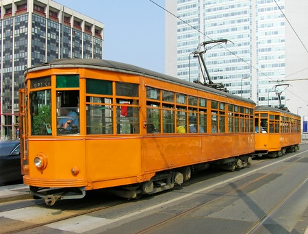 Old orange trams in Milan, Italy